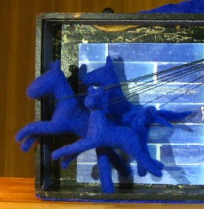 with blue felted horses to be held.