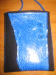 The blue leather is fish skin, brought back from Iceland.